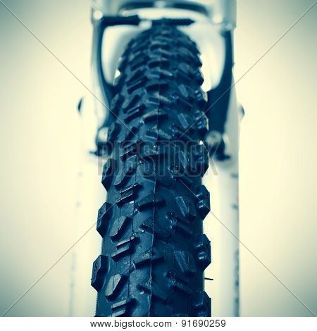 closeup of the front wheel of a mountain bike with a new tire