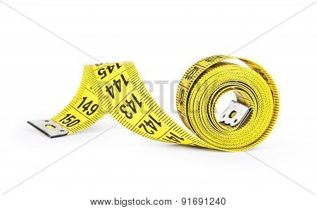 Yellow Tape Measure On Rolled Up On White Background