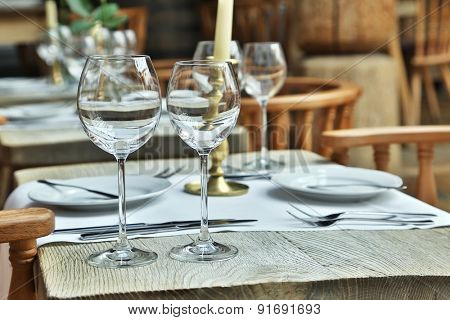 Table setting with wine glasses at the vintage cafe.