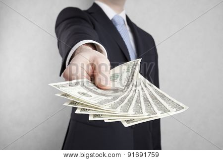 Businessman with american dollars. Clipping path included.