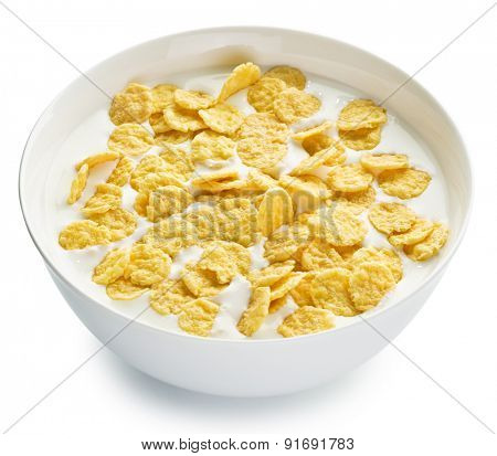 Cornflakes in the bowl on white background. File contains clipping paths.