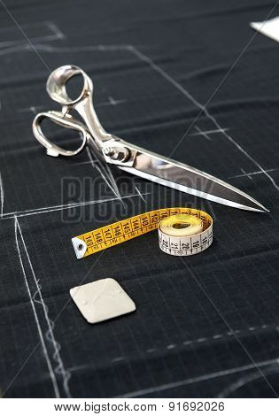 Scissors And Tape Measure On Fabric In Studio