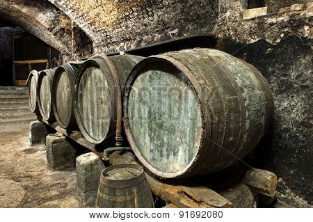 Old Keg Barrels In Row In Old Wine Cellar