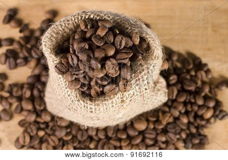 bag of coffee on wooden background