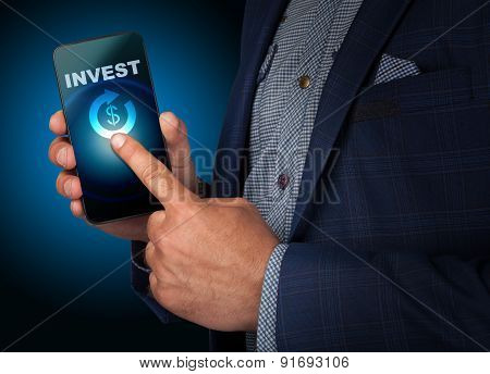 Businessman Presses A Button Touch Screen Smatrfona Invest. Business, Technology, Internet And Netwo