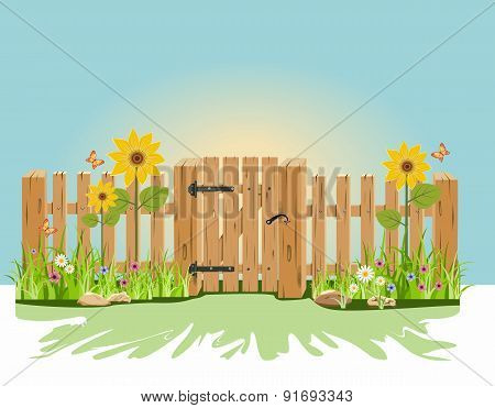 A wooden gate and fence