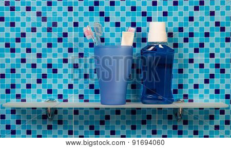 Toothbrushes on bathroom shelf