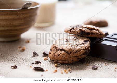 Breakfast table with chocolate biscuits and a cup of milk