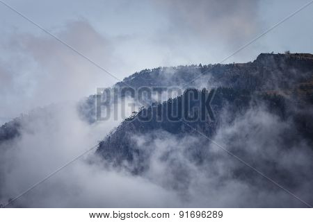 Crests Of Hills In The Fog