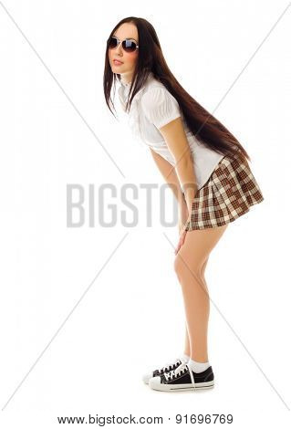School girl in plaid skirt isolated