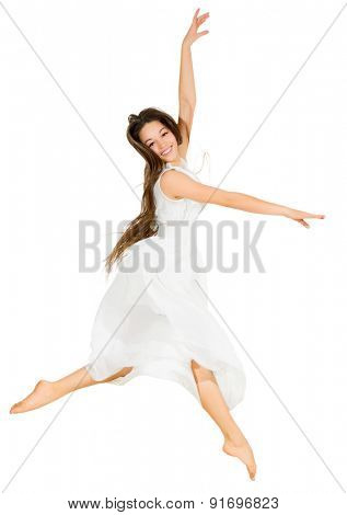 Young dancing girl in white dress isolated