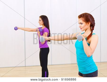 Two girls in fitness club