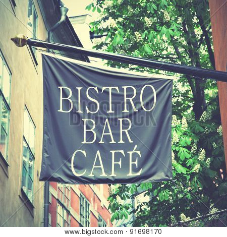Bistro bar cafe sign on flag in the street. Retro style filtred image