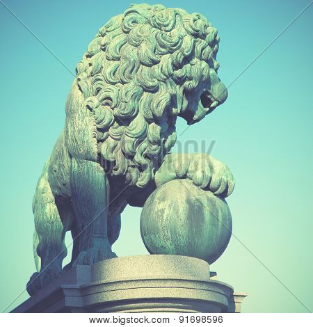 Figure of a lion near the Royal Palace in Stockholm. Retro style filtred image