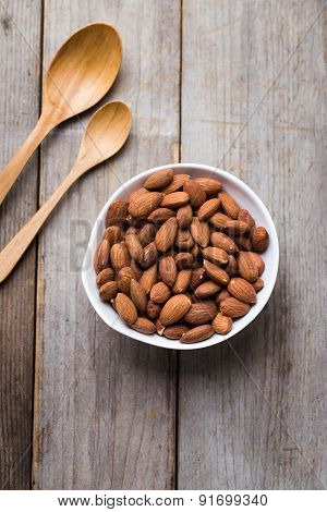 Almond Nuts On Wood Background
