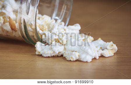 Salted popcorn on wood table