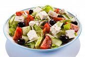 image of greeks  - Greek salad on white background - JPG