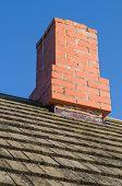 image of chimney  - Redbrick chimney and vintage wooden plank roof - JPG