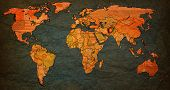 picture of flags world  - afghanistan flag on old vintage world map with national borders - JPG