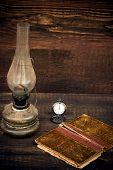 picture of petroleum  - petroleum lampold pocket watch and old book - JPG