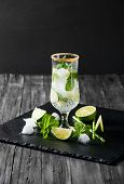 picture of mojito  - Mojito cocktail on black background with lime and mint with copy space - JPG