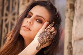 pic of mehendi  - Portrait of a young indian woman in casual style with mehendi on the streets of old city - JPG