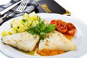 picture of cod  - white dish of Fresh black cod with potatoes and tomatoes sauce - JPG