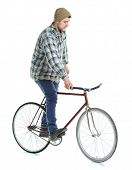 picture of bicycle gear  - Young man doing tricks on fixed gear bicycle on a white background - JPG