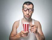 stock photo of pajamas  - Sleepy funny man holding cup coffee or tea beginning a new day - JPG