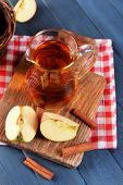 picture of jug  - Glass jug of apple juice on wooden table - JPG