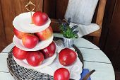 image of serving tray  - Tasty ripe apples on serving tray on table close up - JPG