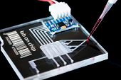 stock photo of biomedical  - A lab on chip is device integrates several laboratory processes in one device - JPG