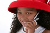 Beautiful Six Year Old Girl In Red Hat With Cellphone poster