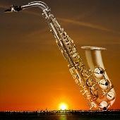 image of saxophones  - abstract night golden background with city and saxophone - JPG