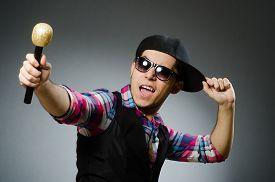image of karaoke  - Funny man singing in karaoke - JPG