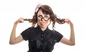 picture of sticking out tongue  - Funny expressive woman sticking her tongue out and playing with her hair isolated on white - JPG
