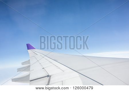 an aero plane wing in the sky