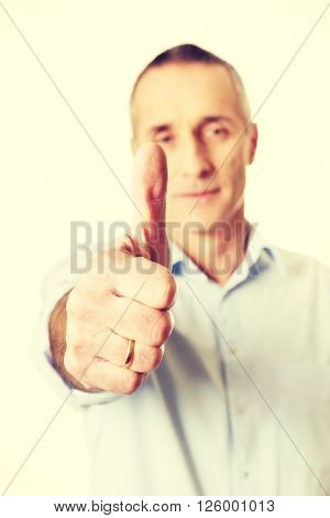 Mature man gesturing ok sign