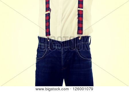 Old fashioned man wearing suspenders.