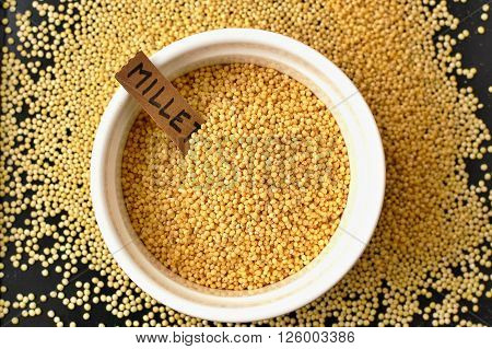 Millet In The Bawl With The Label On The Black Background