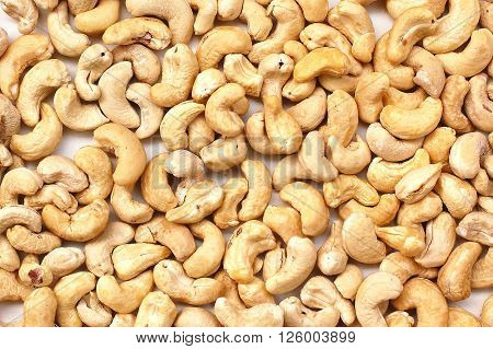 Background From Cashew Nuts On The White Background