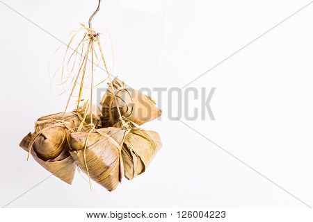 Bunch Of Chinese Rice Dumpling Tied Hanging Against White Background