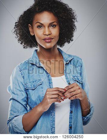 Calm Woman Wearing Red Nail Polish On Gray