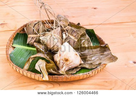 Freshly Steamed Chinese Rice Dumpling On Traditional Rattan Tray