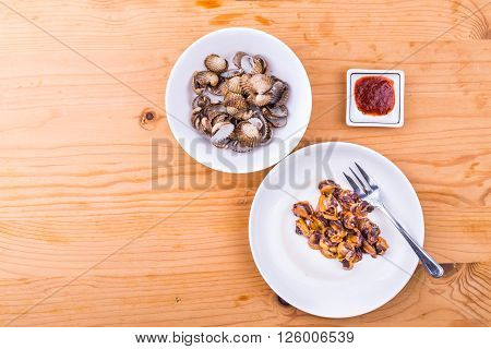 Top view of boiled and prepared cockles with chili dip. It is a delicacy among Asians