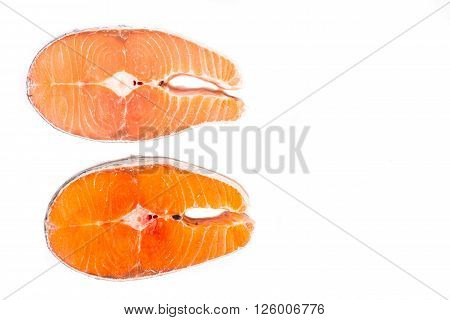 Comparison Between Wild And Farmed Salmon Blocks On White Background