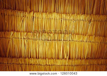 close up thatching roof texture background with vignetting