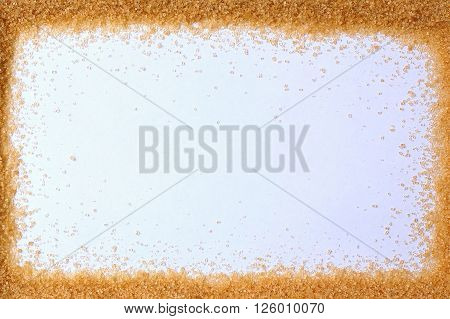 Frame From Brown Cane Sugar On The White Background