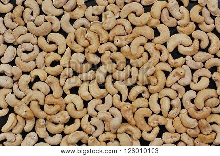 Background From Cashew Nuts On The Black Background