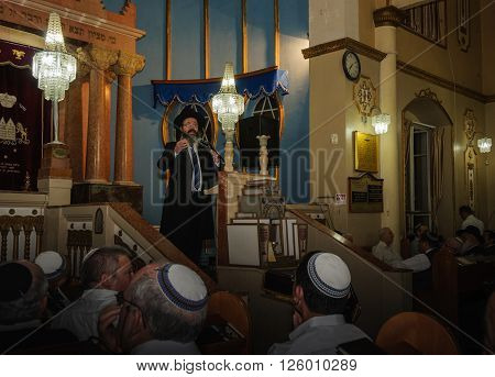 PETACH-TIKVA, ISRAEL - APRIL 22, 2015: Chief Rabbi of Petach-Tikva, Rabbi Benjamin Atias, gives a lecture in the central synagogue on the eve of the 67'th independence day of Israel